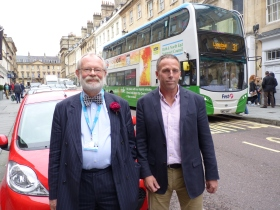 Cllr Anthony Clarke (left) and Councillor Tim Warren with one of the Park and Ride buses.
