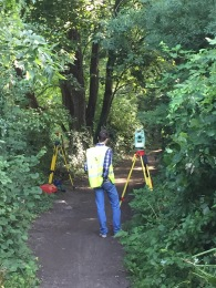 A survey of the path leading up to the canal towpath gets underway.