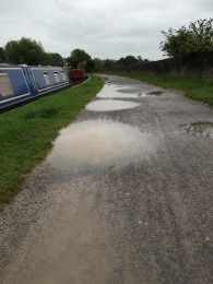 The puddle-covered towpath into Bath.