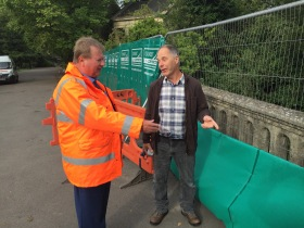 Network Rail's Stakeholder Relationship Manager Graeme Monteith answering questions from a member of the Bath public.