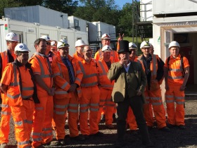 Construction workers pose for a
