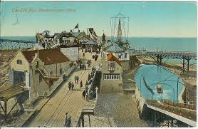 The pier in its heyday - with the lifeboat station and slipway on the left.