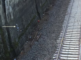 More hooks in place on the railway retaining wall.