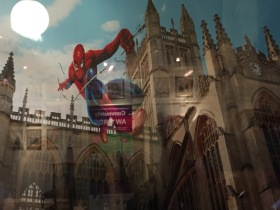 Spiderman on Bath Abbey. This photograph is behind glass and l am afraid the reflections are unavoidable.