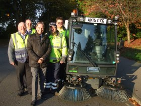 Cllr Veal and members of the team with one of the new street sweepers.