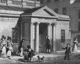 The Paupers' Pump at the Hot Bath in 1829. The pump and pump handle can just be seen inside the portico