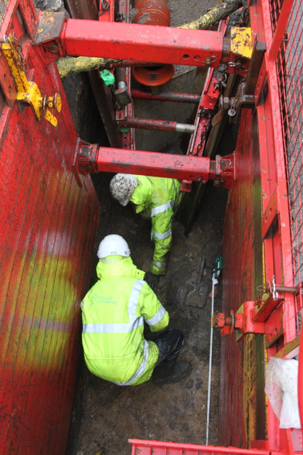 cleaning up of rampart deposits in drainage trench in road