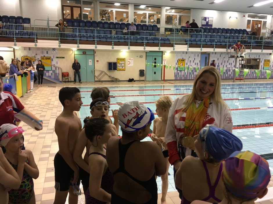 stephanie-millward-mbe-pool-side-with-bath-dolphin-swimmers