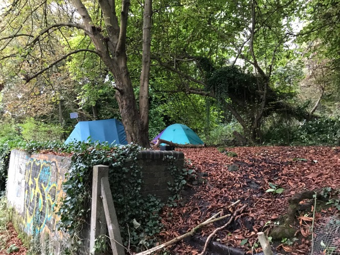 Tents and a new fence on the canalslopes.